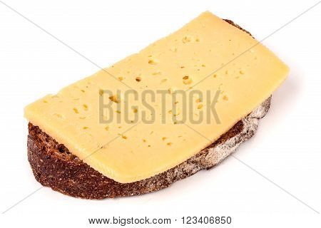 Bread with butter and sliced cheese on white background.