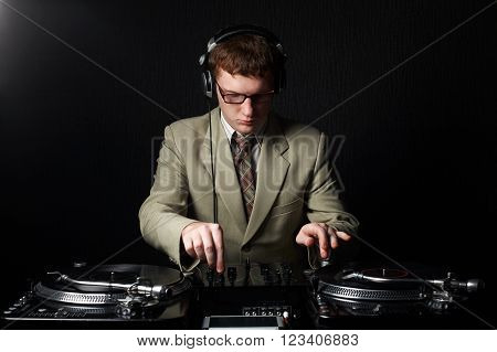 photo of funny red haired DJ on dark background