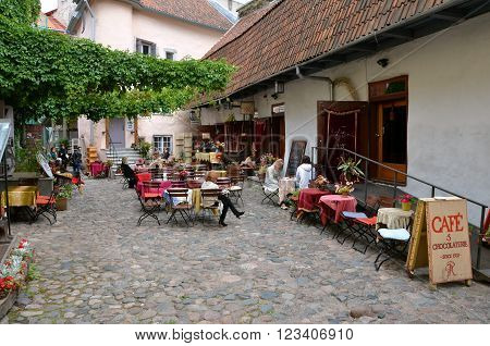 TALLINN / ESTONIA - July 21 2013: Summer terrace of traditional cafe and chocolaterie in historical town of Tallinn