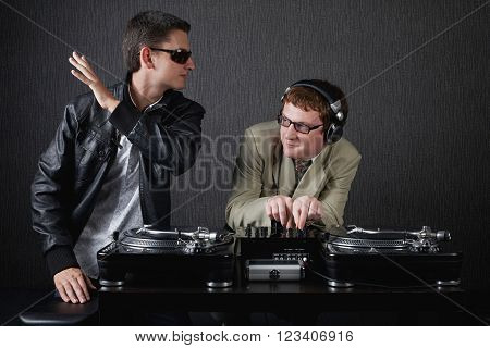 photo of two funny boys with dj booth