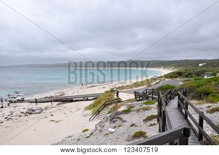 HAMELIN BAY,WA,AUSTRALIA-JANUARY 17,2016: Elevated view from boardwalk of people and boat launch ramp with turquoise Indian Ocean waters under stormy skies in Hamelin Bay, Western Australia.