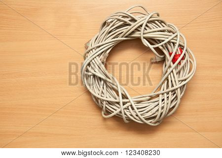 Cable Bay On A Wooden Background. Twisted Pair, Hank.