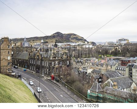 EDINBURGH, SCOTLAND - MARCH 5: Cityscape of t Edinburgh Old Town and Arthur's Seat on the background at March 5, 2016
