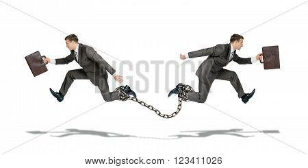 Two businessmen with chain running in different ways isolated on white background