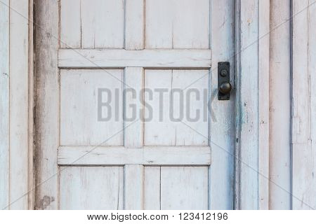 Traditional Door Knob on old white wooden door