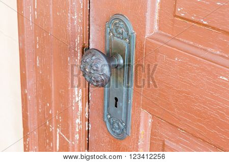 Traditional Door Knob on old wooden door. close up.