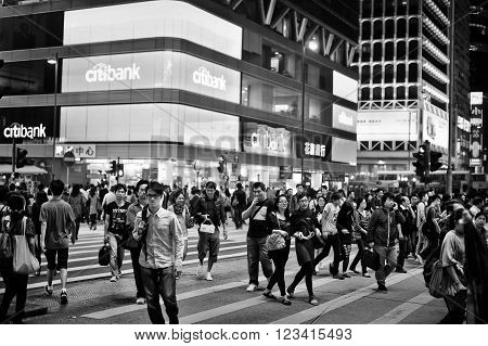 HONG KONG CHINA - NOVEMBER 20 2011: people on the streets of Kowloon Hong Kong on november 20 2011. Hong Kong is one of the most densely populated countries in the world.