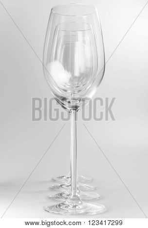 Four crystal wine glasses in a row