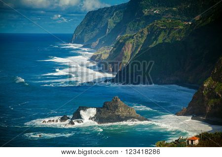 ocean view of the waves dashing against the cliff on the northern coast of Madeira, Portugal