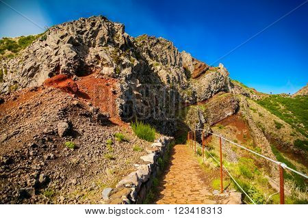 colorful volcanic mountain landscape with hiking path at Pico do Arieiro Madeira Portugal