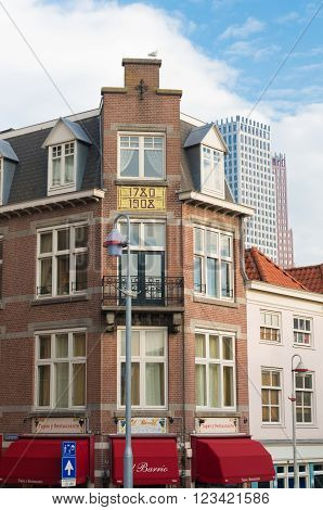 THE HAGUE NETHERLANDS - OCTOBER 3 2015: Facade of a store in typical dutch architecture in the city center of The Hague. The Dutch government and parliament are located in the city and it is the residence of the royal family