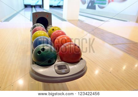 Colorful Bowling balls in ball return, close up