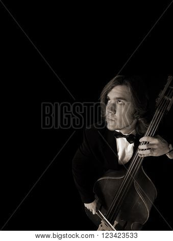 Musician looking at the sky over black background