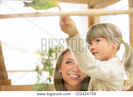 Family with parrot in zoo