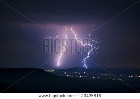 Lightning storm over the mountains at night