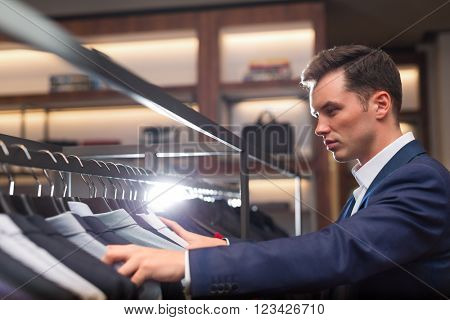 Young businessman in suit indoors