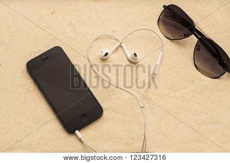 Phone With Headphones And Sunglasses