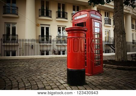 Telephone box and mail box in London street.