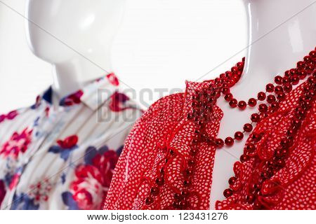 Shirt and necklace on mannequin. Mannequins in classy apparel. Summer clothing for young people. Fashion clothes for modern youth.