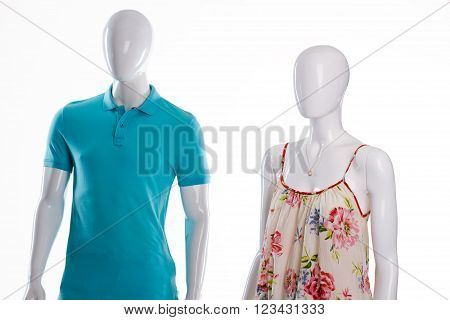 T-shirt and sarafan on mannequins. Mannequins in casual summer clothing. Men's polo and woman's sarafan. Casual clothes sale.