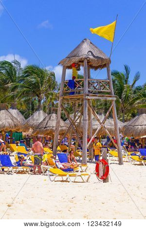 PLAYA DEL CARMEN, MEXICO - JULY 13, 2011: Unidentified tourists on the beach of Playacar at Caribbean Sea in Mexico. This resort area is popular tourist destination with the most beautiful beaches.