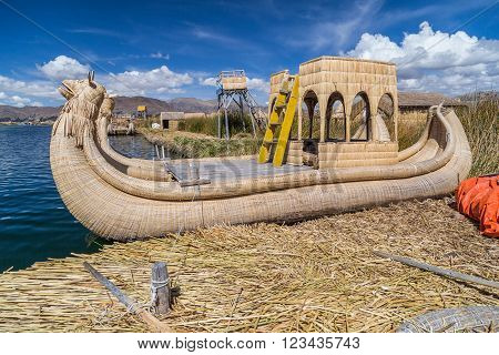 Canoe Boat At Uros Floating Island And Village On Lake Titicaca Near Puno,  Peru