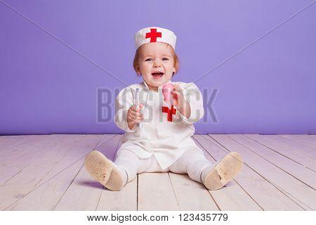 little girl junior little doctor in studio
