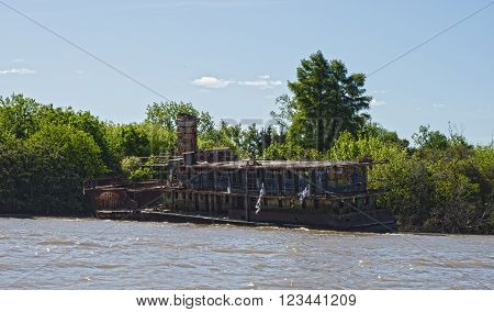 Buenos Aires Argentina - 29th October 2015: Derelict abandoned ship seen during a boat trip in the River Plate delta.