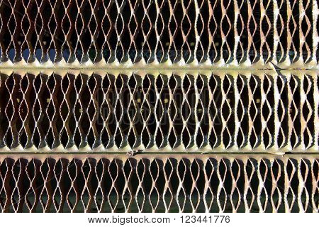 background patterns and texture of an old mettle grate