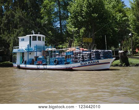 Buenos Aires Argentina - 29th October 2015: Grocery delivery boat seen during a boat trip in the River Plate delta.