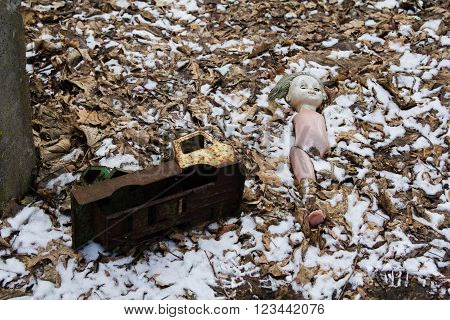 Old abandoned doll and truck in the snow