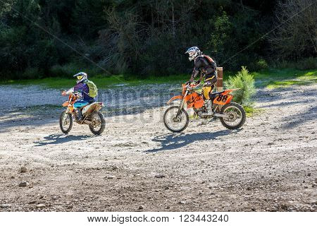 NEVE SHALOM ISRAEL - MARCH 24: Two riders on sports bikes riding along a country road in the forest in Neve Shalom Israel on March 24 2016