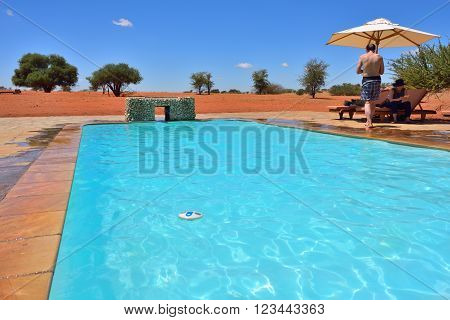 Swimming Pool In The Kalahari Desert