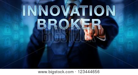 Corporate client pushing INNOVATION BROKER on a screen. Business metaphor and information technology concept for IT departments assuming the role of innovation broker in the area of virtualization.