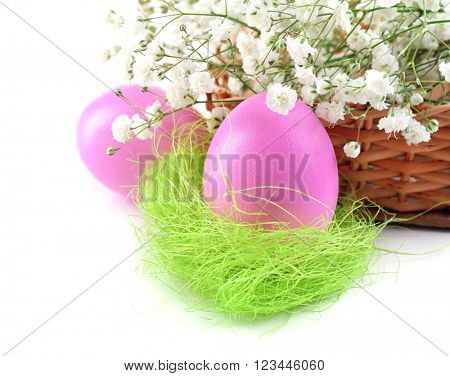 Multicoloured Easter eggs and gypsophila isolated on white