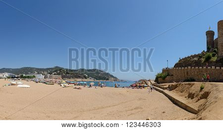TOSSA DE MAR, CATLONIA, SPAIN - JUNE 19: Resort vacationers are visiting Platja Gran beach near