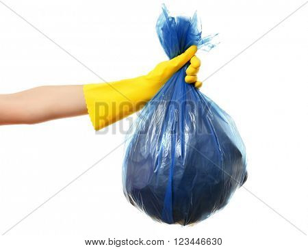 Female hand holding garbage bag, isolated on white