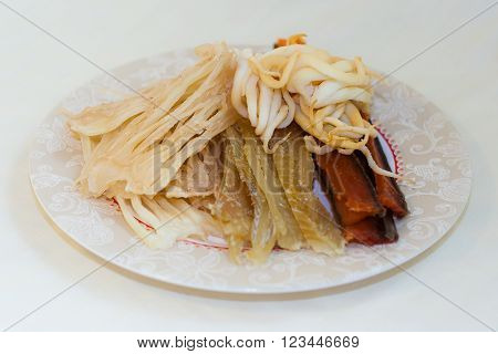 Dried Salted And Smoked Squid Calamari And Fish - Seafood In Russian Far Eastern  Cuisine