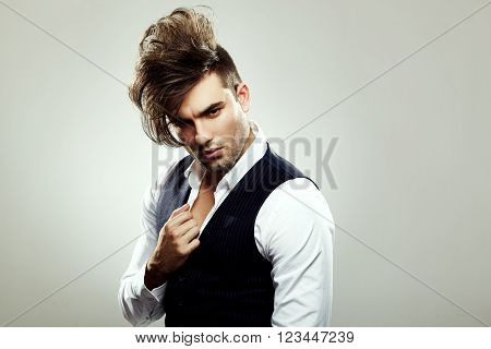 Young fashionable man posing in the studio