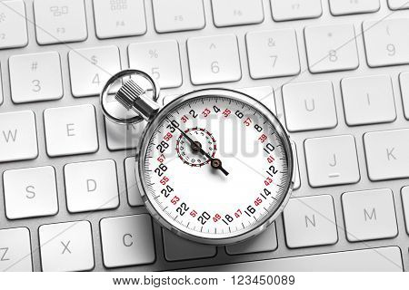 Stopwatch on white keyboard background, close up