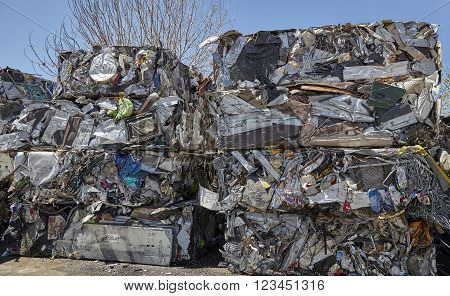 Scrap metal waste compacted cubes for recycling unidentified industrial garbage