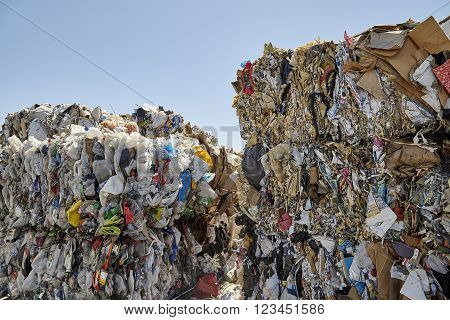 Waste plastic paper bails for recycling unidentified industrial refuse