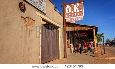 TOMBSTONE, ARIZONA - MARCH 20: Tourists near the landmark OK Corral sign in Tombstone, Arizona on March 20th, 2016.