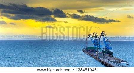 a row of crane at the seaport in Sakhalin island