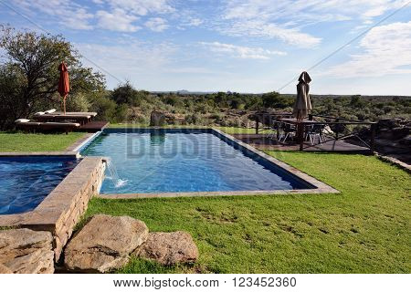 WINDHOEK NAMIBIA - FEB 06 2016: Swimming pool in Naankuse Lodge one from the most famous and popular place nearby Windhoek to stay and relax during safari