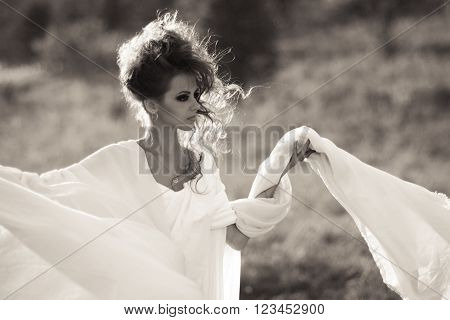 Very beautiful, excellent, awesome, breathtaking, fabulous heroine. Very beautiful girl with fashionable,glamorous hairstyle and makeup, with white, long dress. Proud, powerful, confident girl with strong look.