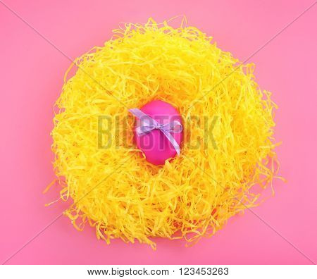 Easter egg in straw nest, top view
