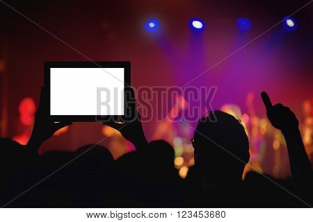 Rock concert crowd recording performance with digital tablet blank display as copy space.