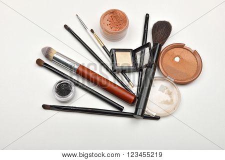 Close-up Of Open Jar Of Loose Powder, Compact Powder, Eyeliner, Eyebrow Powder, Eyeshadow Makeup Bru