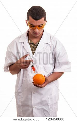 Scientist Injecting Gmo Into Orange, Genetic Modification Of Fresh Fruits